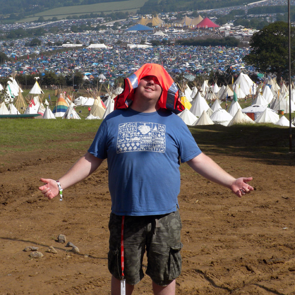 Rob Donovan beckoning to Narnia whilst working at Glastonbury Festival